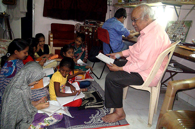 Mr Ashraf with his students. A former Indian Oil employee, he wrote columns for the Navbharat Times for many years.