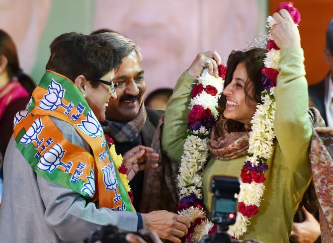 Kiran Bedi and Satish Upadhaya greet Shazia Ilmi as she joins the BJP.