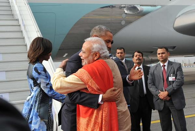 Prime Minister Narendra Modi hugs US President Barack Obama as Michelle Obama, in a Bibhu Mohapatra dress, greets other members of the welcoming party.