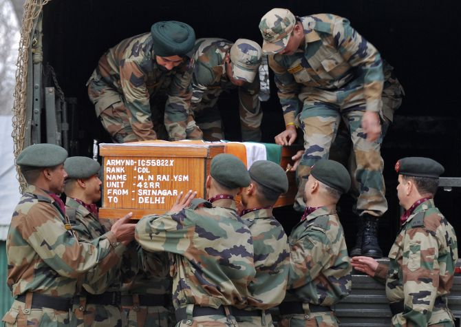 Soldiers carry Colonel M N Rai's coffin. The colonel was killed in a gun battle with terrorists in Kashmir. Photograph: Reuters