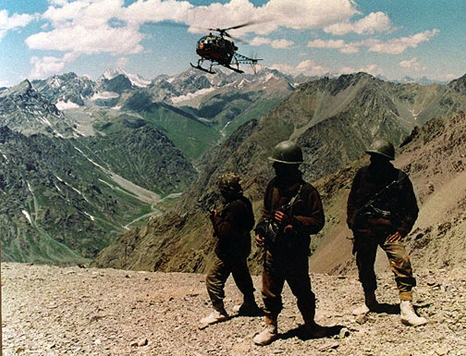 Indian armymen on a mountain peak in Kargil during the 1999 war. Rediff Archives