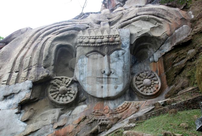 The rock-cut Shiva head at Unakoti, Tripura.