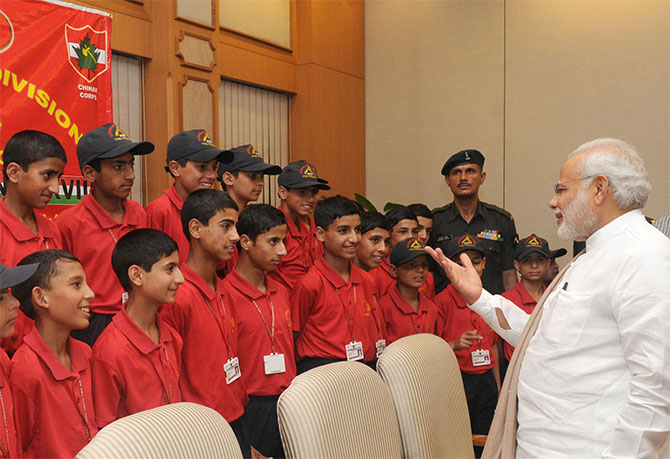 Prime Minister Narendra Modi interacts with children from Jammu and Kashmir, May 30. Photograph: Press Information Bureau