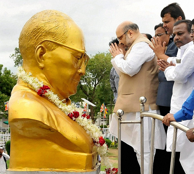Amit Shah and other BJP leaders before a statue of Dr Ambedkar