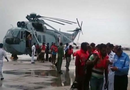 Navy saves 20 people from listing vessel in dramatic rescue ops