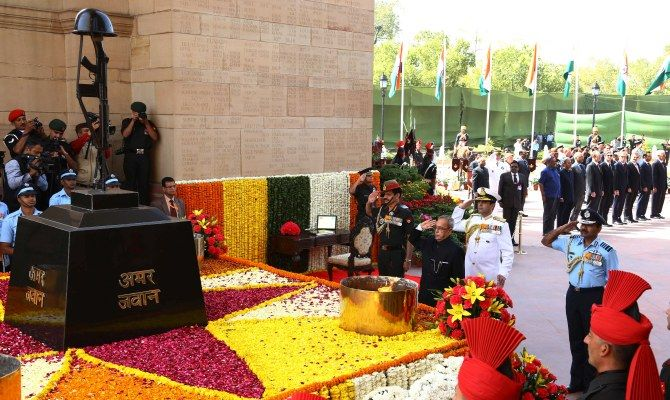 President Pranab Mukherjee pays tribute to fallen soldiers at the Amar Jawan Jyoti in New Delhi.