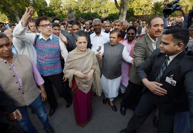 Congress President Sonia Gandhi, Janata Dal-United President Sharad Yadav, CPI Secretary D Raja, Trinamool MP Derek O'Brien and other Opposition leaders march from Parliament to Rashtrapati Bhavan to protest against the land bill, March 17, 2015. Photograph: Subhav Shukla/PTI Photo