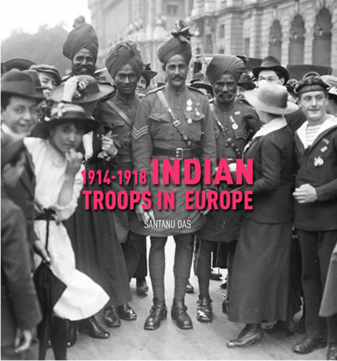 Parisians cheer Indian soldiers after the Bastille Day Parade.