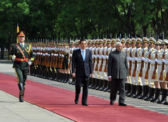 Narendra Modi inspects a guard of honour in Beijing