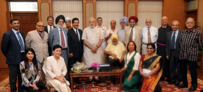 Captain M S Kohli (in black turban) and his team with Prime Minister Narendra Modi