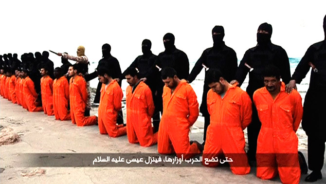 Men in orange jumpsuits, said to be Egyptian Christians, minutes before they were murdered by the ISIS.