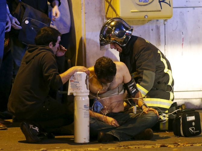 French security help an injured Frenchman near the Bataclan concert hall, the scene of the worst terror attack in Paris that horrific Friday night. Photograph: Christian Hartmann/Reuters
