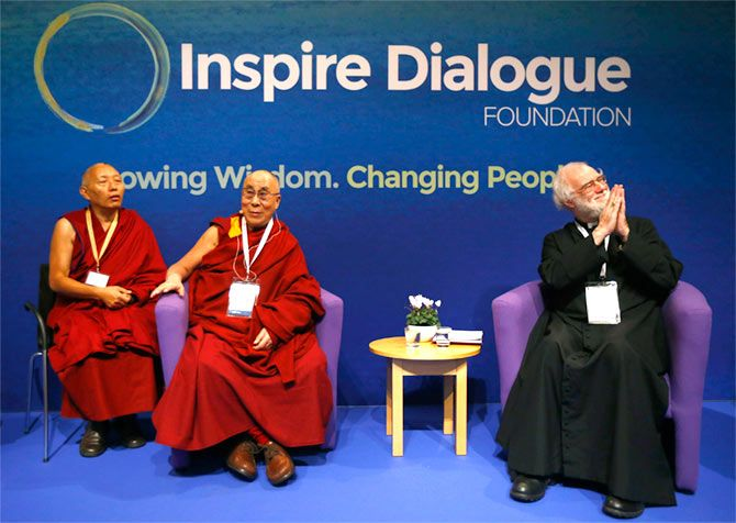 The Dalai Lama with the former Archbishop of Canterbury Lord Williams, right, at Magdalene College in Cambridge, September 16.  Photograph: Darren Staples/Reuters