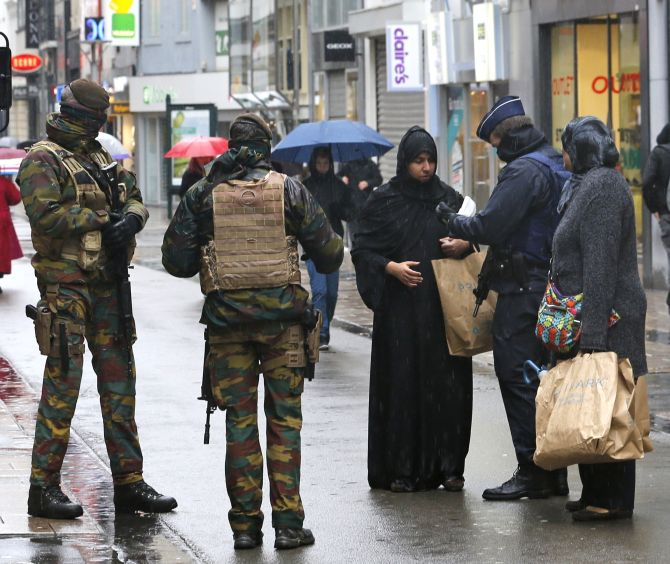 Belgian security personnel check the documents of a Muslim woman in central Brussels, last November, soon after the Paris attacks. Photograph: Youssef Boudlal/ Reuters