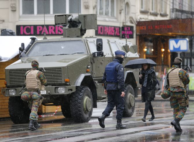 Belgian soldiers patrol central Brussels after Belgium was put on lockdown for fears of a terror attack. Photograph: Youssef Boudlal/Reuters
