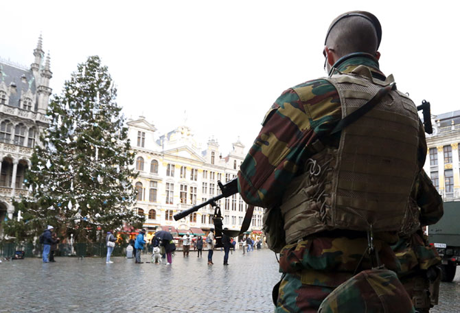 A Belgian soldier keeps guard on Brussels' Grand Place.