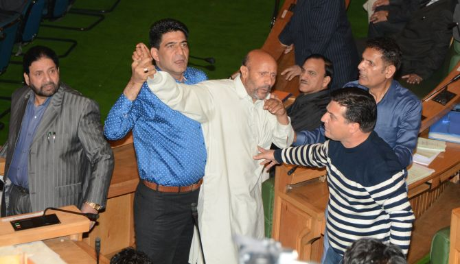 Independent J&K MLA Engineer Rashid being taken away after the attack