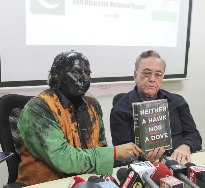 Author-journalist Sudheendra Kulkarni, left, after Shiv Sainiks hurled paint and ink on him for hosting a book release event featuring former Pakistan foreign minister Khurshid Kasuri, right.