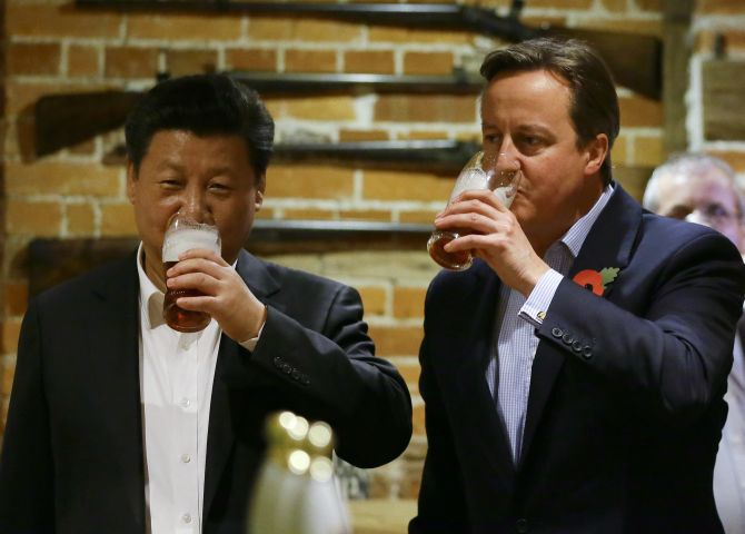 Xi Jinping and David Cameron enjoy a pint of lager at the The Plough at Cadsden pub. Photograph: Kirsty Wigglesworth-WPA Pool/Getty Images