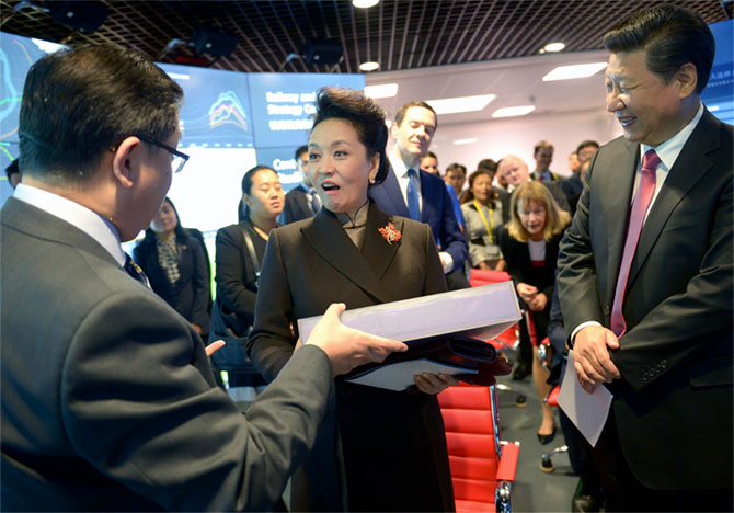 Chinese First Lady Peng Liyuan is surprised with a gift by Professor Yike Guo during a visit to the Imperial College in London, October 21, as her husband President Xi Jinping smiles and Britain's Chancellor of the Exchequer George Osborne leans forward to get a better look. Photograph: Anthony Devlin/Reuters