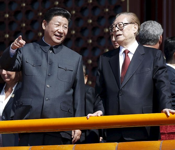 Chinese President Xi Jinping, left, with one of his predecessors Jiang Zemin at the military parade in Beijing, September 3, 2015. Photograph: Wang Zhao/Reuters