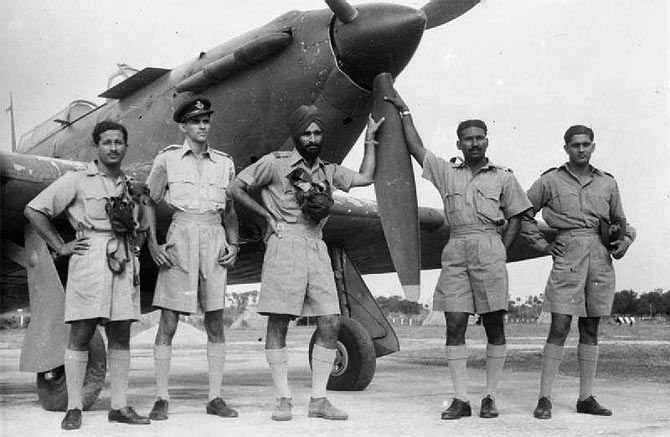 Marshal of the Air Force Arjan Singh as Flight Lieutenant with pilots of No 1 Squadron by a Hawker Hurricane aircraft in World War II in Burma. Photograph: Kind courtesy Imperial War Museum/Wikipedia.org