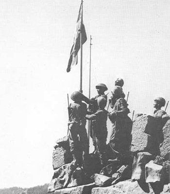 Indian troops raise the tricolour at Haji Pir Pass after vanquishing the Pakistan army in the 1965 war