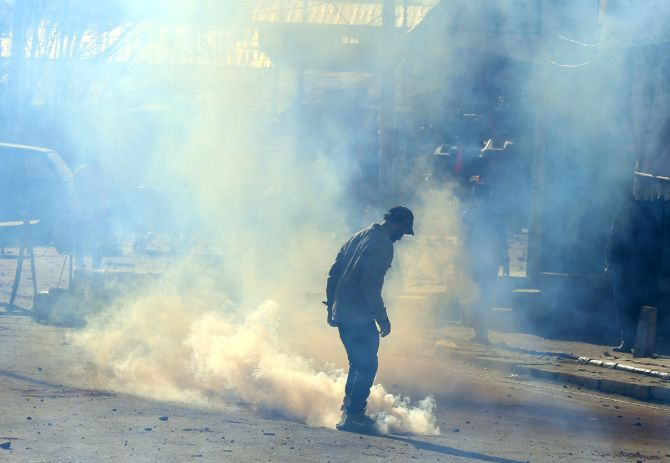 Police fire tear gas at protestors after the Hanwara incident, April 12. Photograph: Umar Ganie