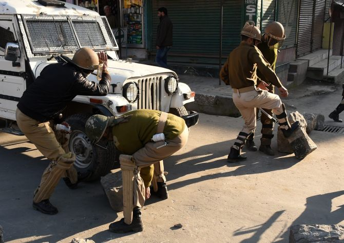 Security personnel remove boulders from a deserted street. The separatists have called for a shutdown to protest the four deaths when the army allegedly opened fire. Photograph: S Irfan/PTI