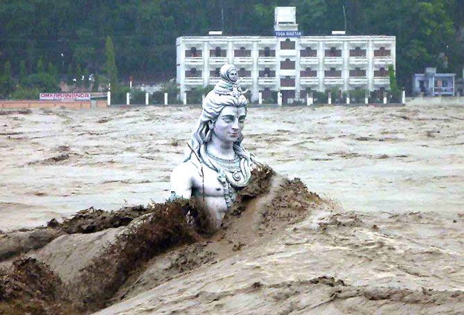 A submerged statue of Lord Shiva stands amid the flooded waters of river Ganges at Rishikesh in 2013.
