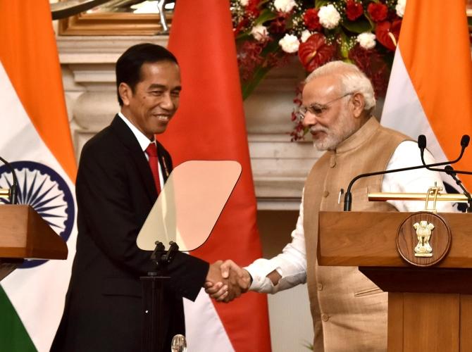 Indonesian President Joko Widodo with Prime Minister Narendra Damodardas Modi