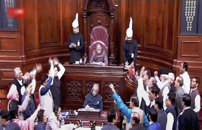 A TV grab of members protesting in the Rajya Sabha during the winter session of Parliament