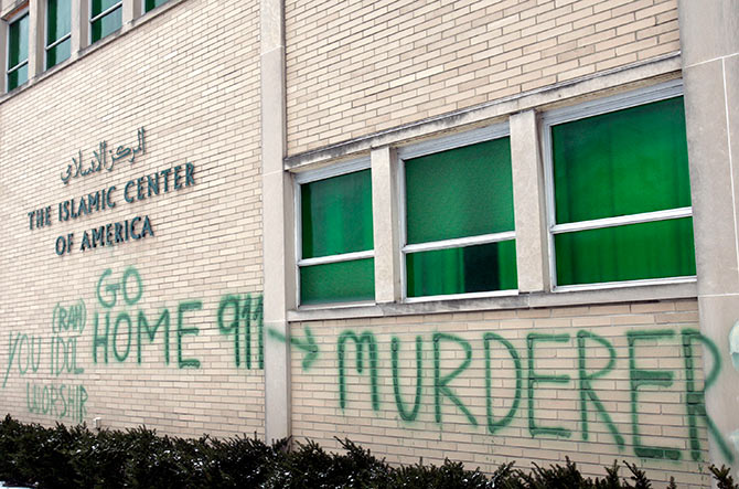 Anti-Muslim graffiti is seen on the wall of the Islamic Center of America in Detroit, Michigan January 23, 2007