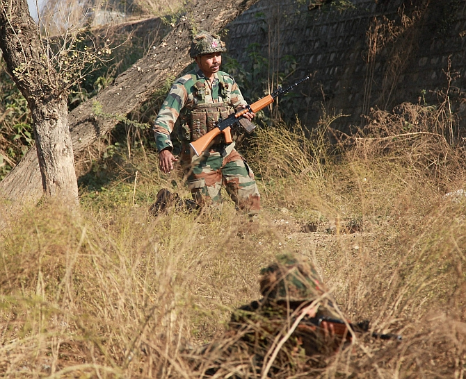 Soldiers conduct a search operation in a forest area outside the Indian Air Force base in Pathankot on Sunday, January 3. Photograph: PTI Photo