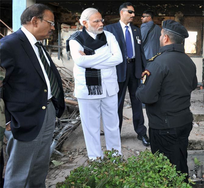Prime Minister Narendra Damodardas Modi and National Security Advisor Ajit Kumar Doval, left, at the scene of the encounter with terrorists at the Indian Air Force base in Pathankot, January 9, 2016. Photograph: Press Information Bureau