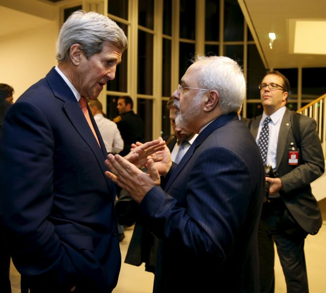 US Secretary of State John Kerry with Iranian Foreign Minister Mohammad Javad Zarif after the International Atomic Energy Agency verified that Iran has met all conditions under the nuclear deal, in Vienna. Photograph: Kevin Lamarque/Reuters