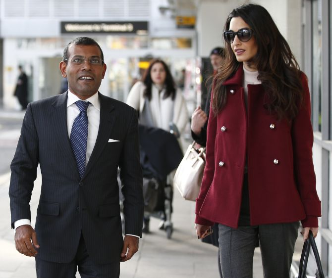 Deposed Maldivian president Mohamed Nasheed at Heathrow airport in London, January 21, 2016, with his lawyer Amal Clooney. Nasheed was granted medical leave from his 13-year jail sentence to have spinal surgery. Photograph: Peter Nicholls/Reuters