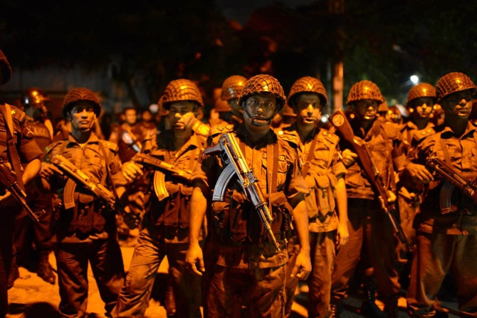 Bangladesh security personnel outside the restaurant. Photograph: Mahmud Hossain Opu/Getty Images
