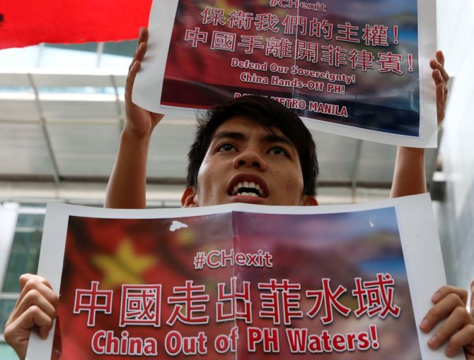 A demonstrator chants slogans during a protest over the South China Sea disputes outside the Chinese consulate in Makati City, Metro Manila, Philippines
