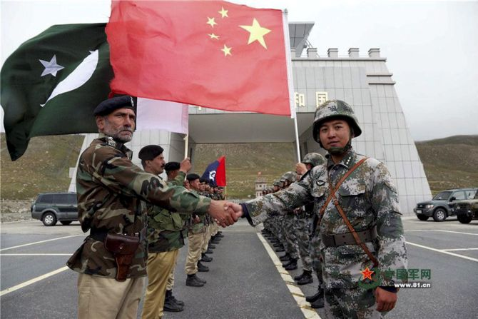 Chinese and Pakistan troops jointly patrol the border connecting Pakistan occupied Kashmir with China's Xinjiang region. PTI Photo, Courtesy The People's Daily Online