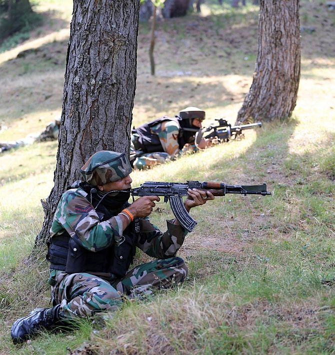 Indian soldiers in Kashmir. Photograph: Umar Ganie for Rediff.com