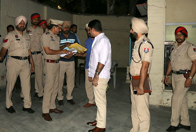 Swapan Sharma, the Senior Superintendent of Police, Bathinda with his officers