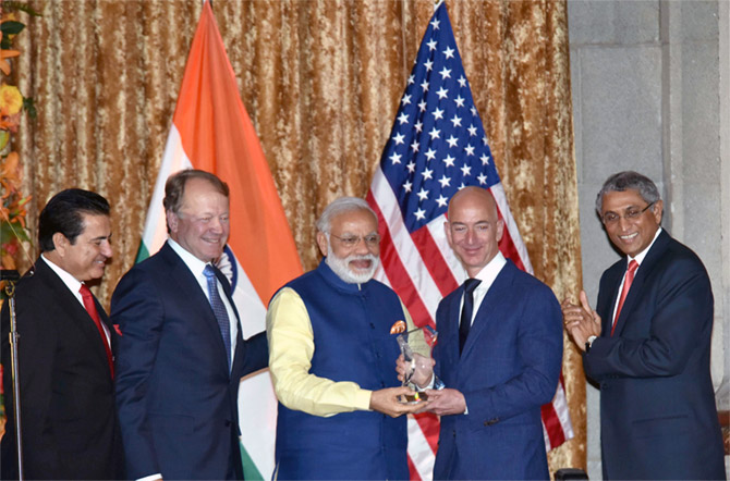 Then USIBC President Dr Mukesh Aghi, left, CISCO CEO John Chambers, second from left, watch Prime Minister Narendra D Modi present the USIBC Global Leadership Award to Amazon founder Jeff Bezos, Washington, DC, June 7, 2016. Photograph: Press Information Bureau