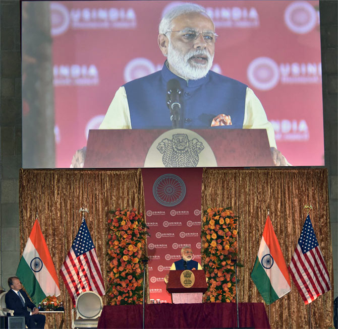 Cisco Chairman John Chambers watches Prime Minister Narendra Modi address the US-India Business Council's 40th annual general meeting, Washington, DC, June 7, 2016.