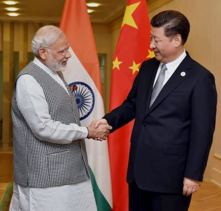 Prime Minister Narendra Modi with Chinese President Xi Jinping on the sidelines of the SCO meeting in Tashkent. Photograph: PTI