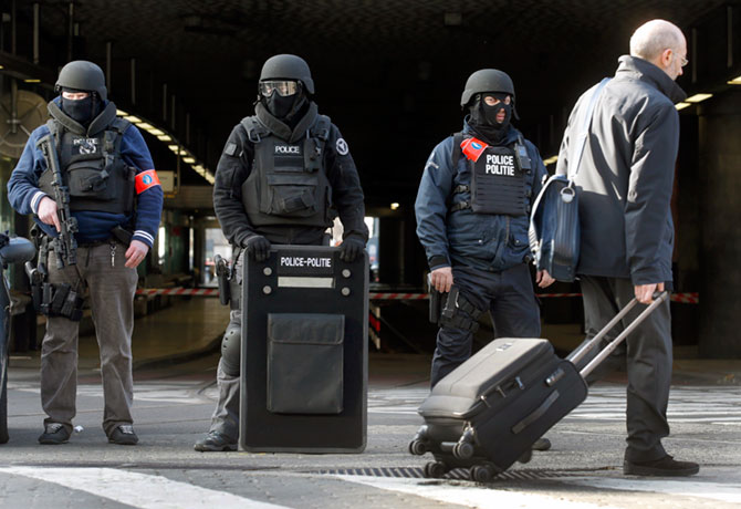 Policemen stand guard at the Midi train station following the bomb attacks in Brussels, March 22, 2016. Photograph: Christian Hartmann/Reuters