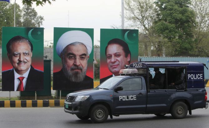 Portraits of Pakistan's President Mamnoon Hussain, Iranian President Hassan Rouhani and Pakistan's Prime Minister Nawaz Sharif displayed during Rouhani's visit to Islamabad, March 2016. Photograph: Faisal Mahmood/Reuters