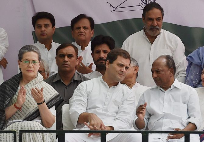 Sonia Gandhi and Rahul Gandhi at the Save Democracy rally at Jantar Mantar, New Delhi, May 6, 2016. Ahmed Patel can be seen, centre, standing. Photograph: Vijay Verma/PTI Photo