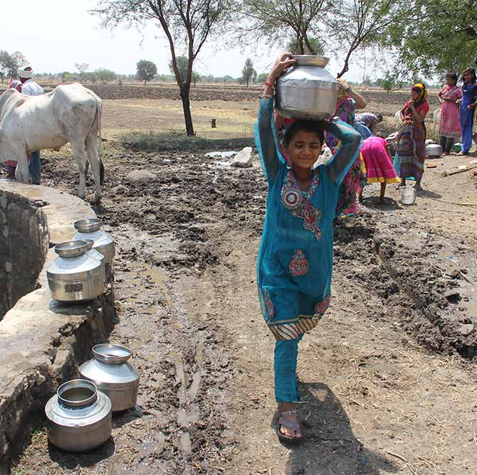 A child collects water in drought hit Maharashtra.