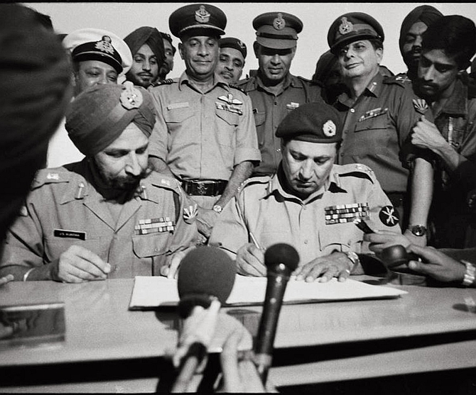The most famous photograph in Indian military history! Lieutenant General A A K Niazi, the Pakistan army commander in East Pakistan, signs the Instrument of Surrender, before Lieutenant General Jagjit Singh Aurora, General Officer Commanding in Chief, Eastern Command, December 16, 1971. Photograph: DPR Photo Division Archives